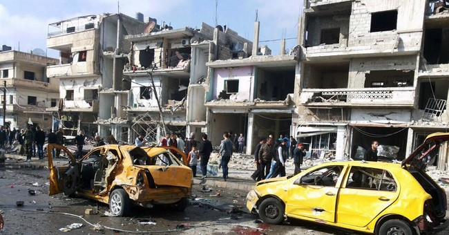 Syria TV: 2 blasts in city of Homs kill 32, wound dozens
