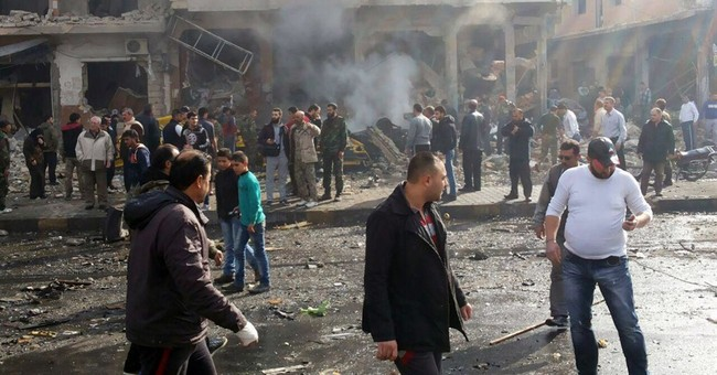 The Latest: Death toll from Damascus bombings climbs to 50