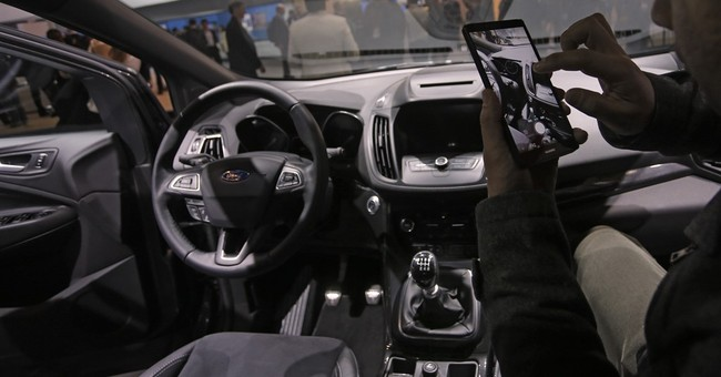 Ford CEO looks to autonomous cars, sharing economy