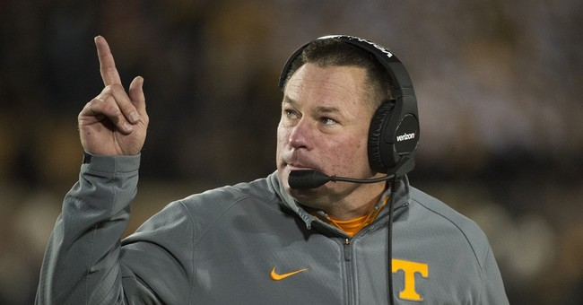 Suit: Ex-Vols player punched for helping woman in rape case