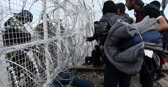 Migrants stranded in Greece, face eviction in France
