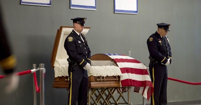 Correction: Officer Slain-Funeral story
