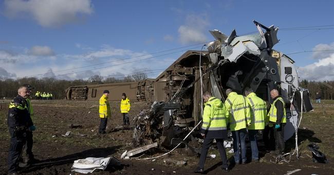 Train driver killed as train hits crane on Dutch crossing