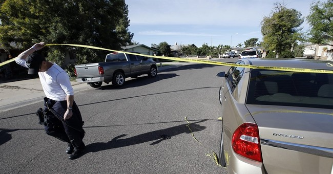 The Latest: Police ID gunman who killed 4 family members