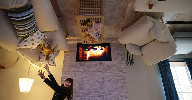 AP Photos: Building this house was topsy-turvy experience