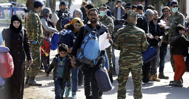 The Latest: NATO: rescued migrants can be returned to Turkey