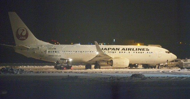 Engine smoke forces evacuation of JAL plane in snow