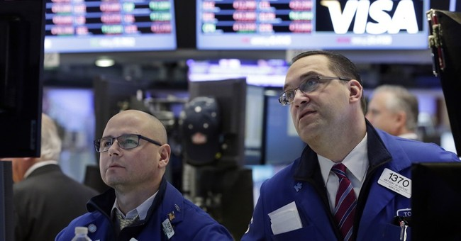 Stocks open lower as weak oil prices push energy sector down