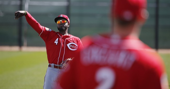 Despite offseason deals, Reds' Phillips back for 11th year