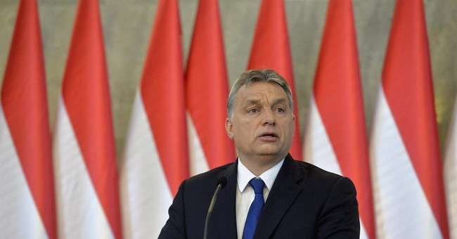 Hungarian leader seeks referendum on EU migrant quotas