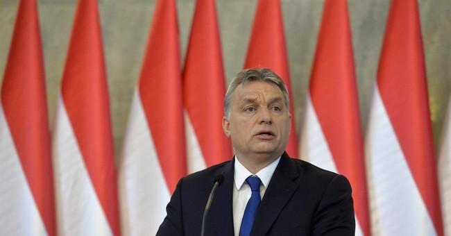 Hungarian leader seeks referendum on EU migrant quotas