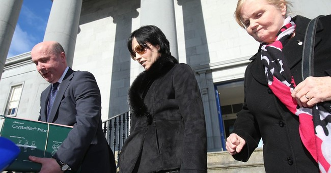 Cranberries singer fined for head-butting and spitting