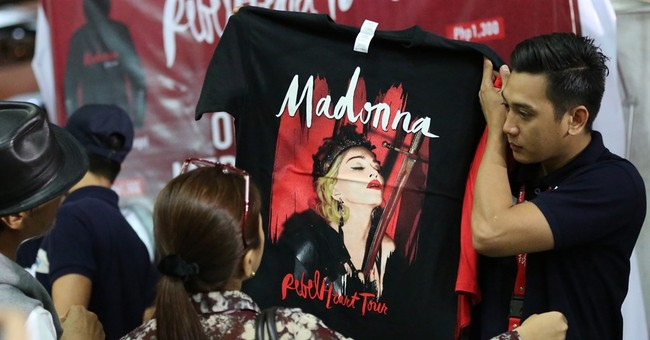 Madonna makes surprise visits to Manila children's shelters