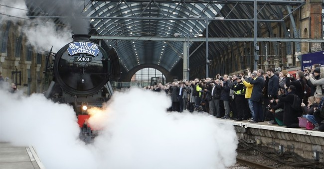 Thousands line tracks to see famed steam engine leave London