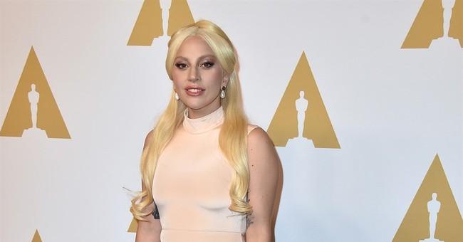 Gaga says assault won't define her after Oscar performance