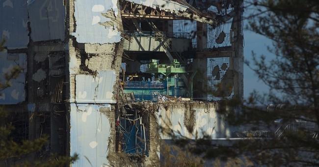 Japan utility admits it delayed report of Fukushima meltdown