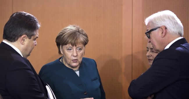 Eurozone inflation revised down, bolstering stimulus case