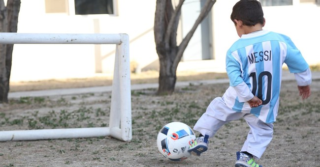 Afghan boy in homemade shirt looking to meet Lionel Messi