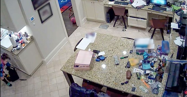 Security video catches hoverboard catching fire in home