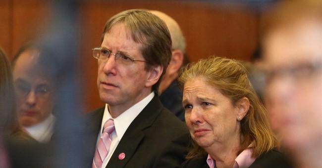 The Latest: Mom of dead teacher says sentence 'unacceptable'