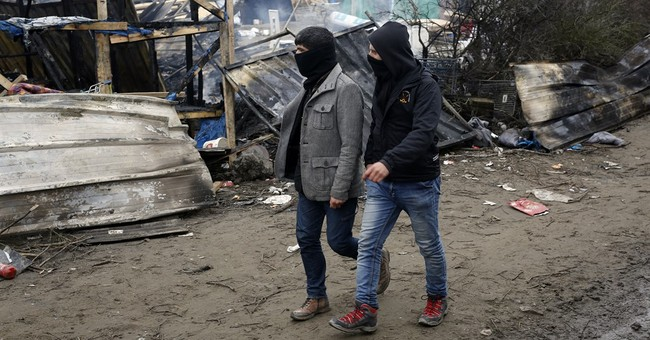French authorities try to pry migrants from camp in eviction