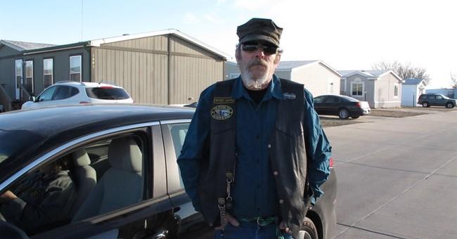 Kansas town grieves shooting with 'Hesston Hustler Strong'