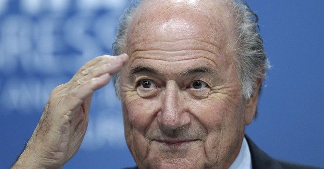 AP Interview: Blatter free of FIFA 'burden,' backs Infantino