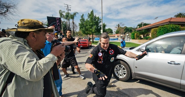 The Latest: Peaceful rally follows weekend KKK confrontation