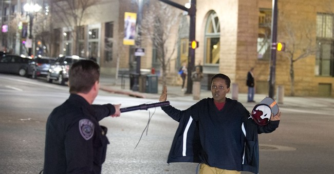 Salt Lake City police battle rock-throwers after shooting
