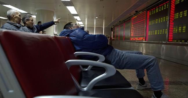 China stocks plunge, trigging another market halt