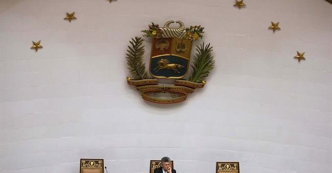 Venezuela opposition swears in lawmakers barred by court