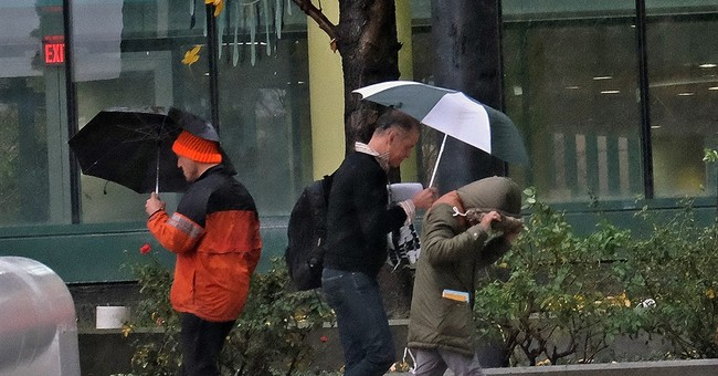 The Latest: Rain, snowfall totals reported after stormy week