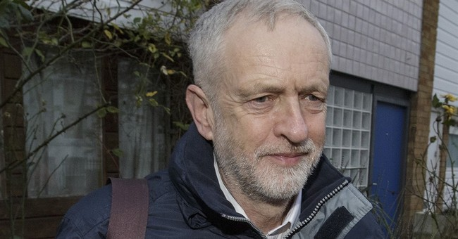Leader of Britain's divided Labour Party fires party rebels