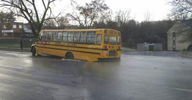 Police: School bus stuck in sinkhole, students OK