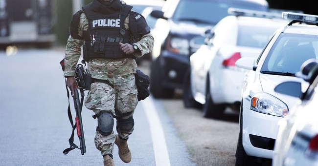 The Latest: Boy and father die after hostage standoff