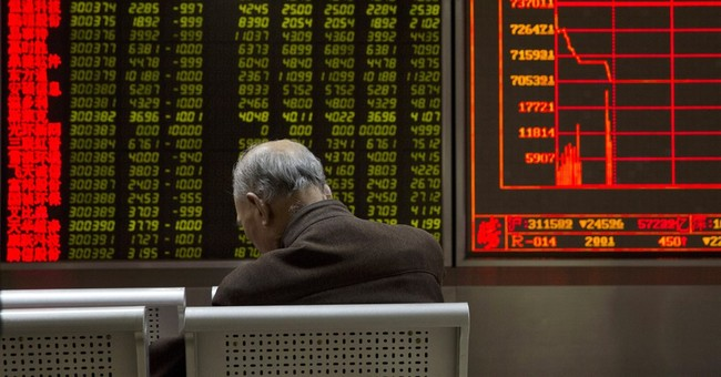 Asian stocks fall as China halted after market plunge