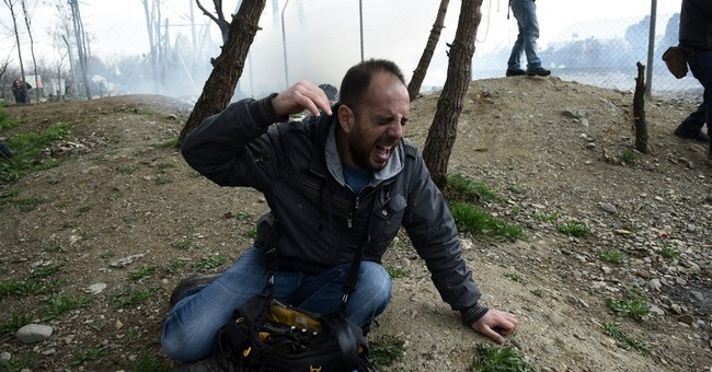 Europe's crisis worsens: Migrants face razor wire, tear gas