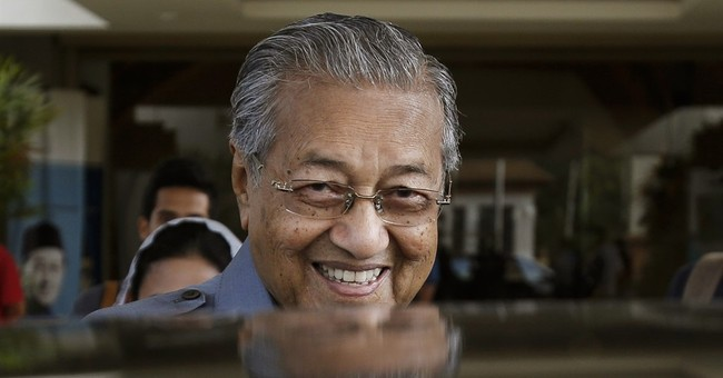 Ex-Malaysian leader Mahathir quits ruling party in protest