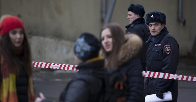 Russian police arrest woman seen waving child's head