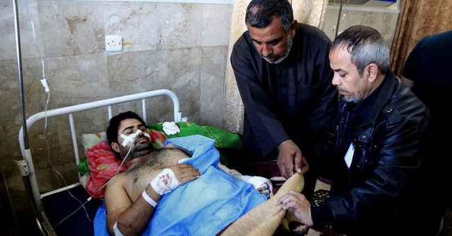 IS suicide bombers hit Iraqi military compound, killing 8