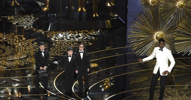 Review: Rock rocks with Oscars monologue; show's a snooze
