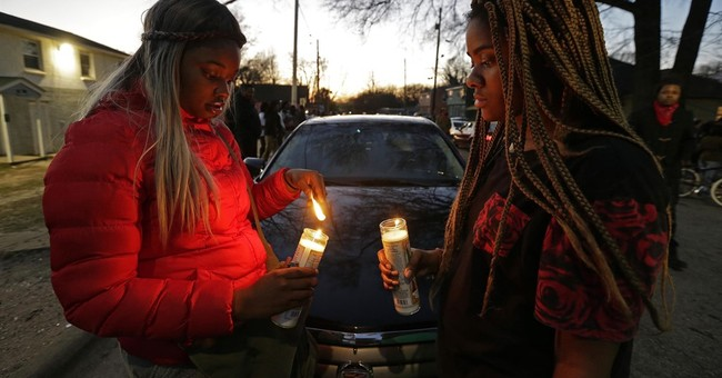 The Latest: Police identify officer who chased, shot man