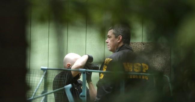 The Latest: Washington gunman had long criminal record