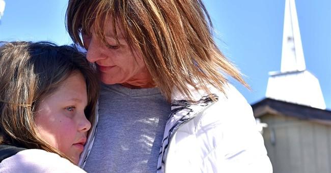 The Latest: Teen enters denial in Ohio school shooting