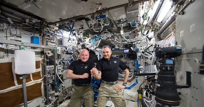The Latest: 2 spacemen back home after year aloft