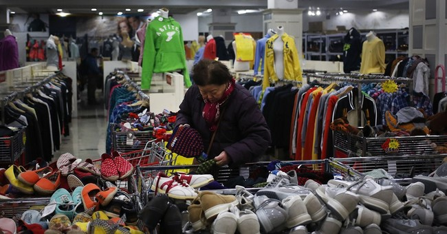 Chinese factories lose more momentum, surveys show