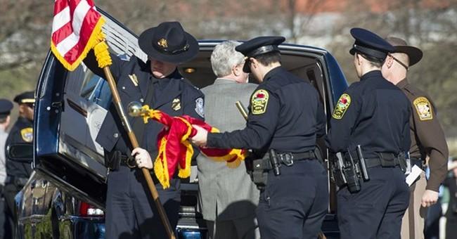 Family, friends, police remember officer slain on 1st shift