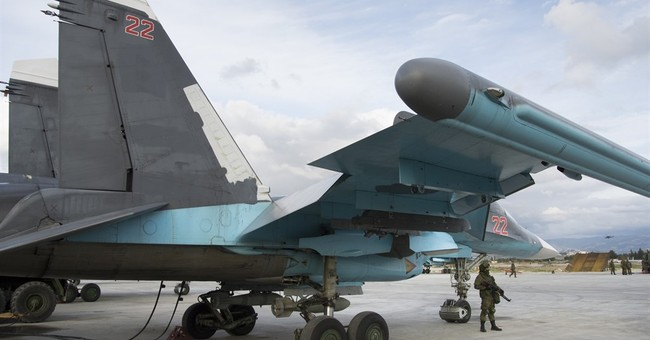 Russian warplanes sit idle on Syria base during cease-fire