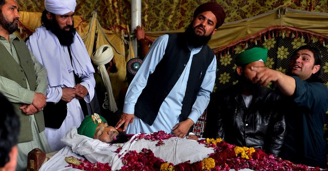 Crowds gather in Pakistan city for funeral of hanged officer