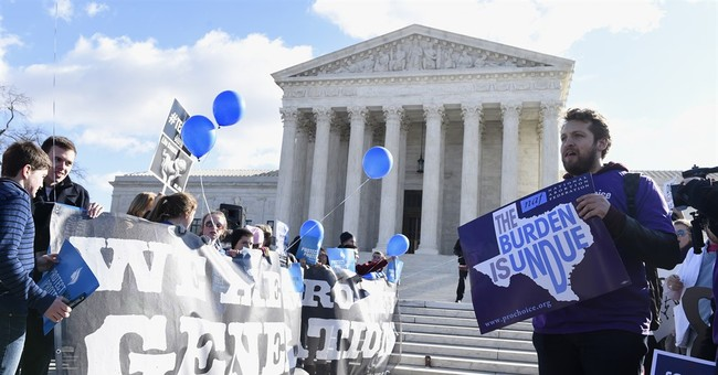 Deeply split Supreme Court wrestles with abortion case